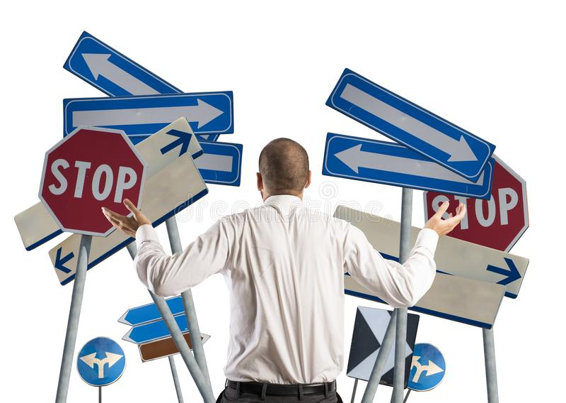 Wahlen und Verwirrung eines Geschäftsmannes lizenzfreie stockfotos