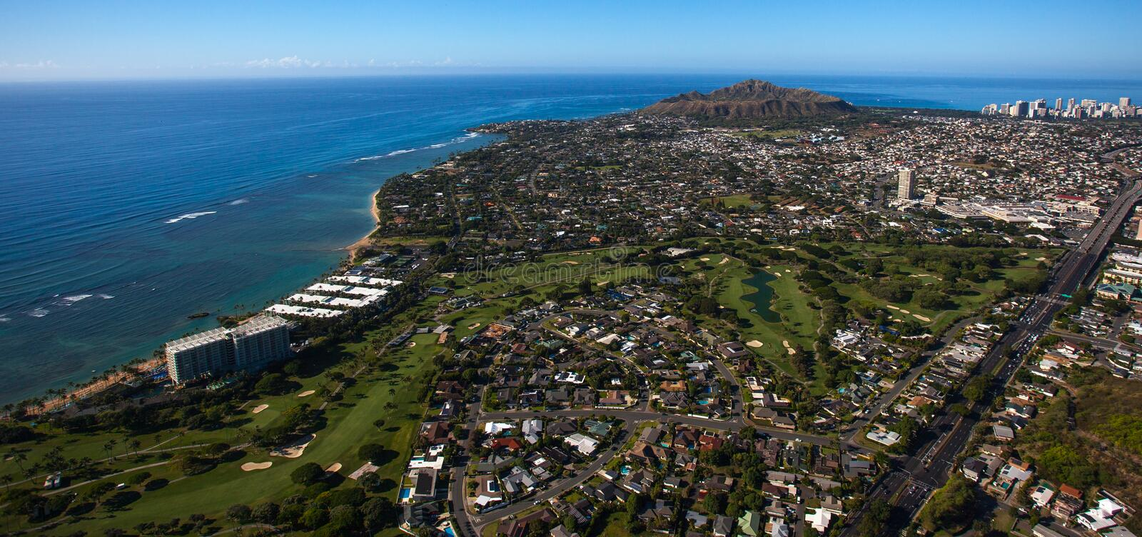 Beautiful aerial view of Diamond Crater and the Waialae golf course and Country Club Oahu, Hawaii. Waialae Country Club is a private country club in Honolulu stock images