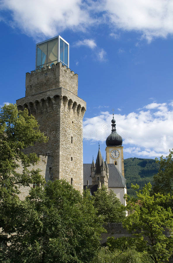 Waidhofen - a town in Austria. Tower with a modern cube at the top and church in a small Austrian town called Waidhofen stock photos
