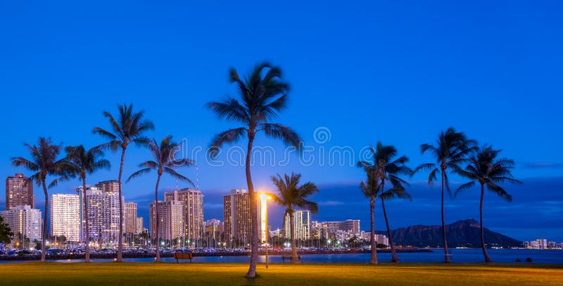 Waikiki beach at dusk stock photo