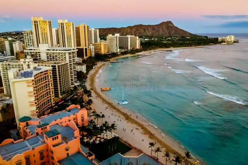 Waikiki Beach Honolulu. View of Waikiki Beach and Honolulu Skyline at sunset stock image