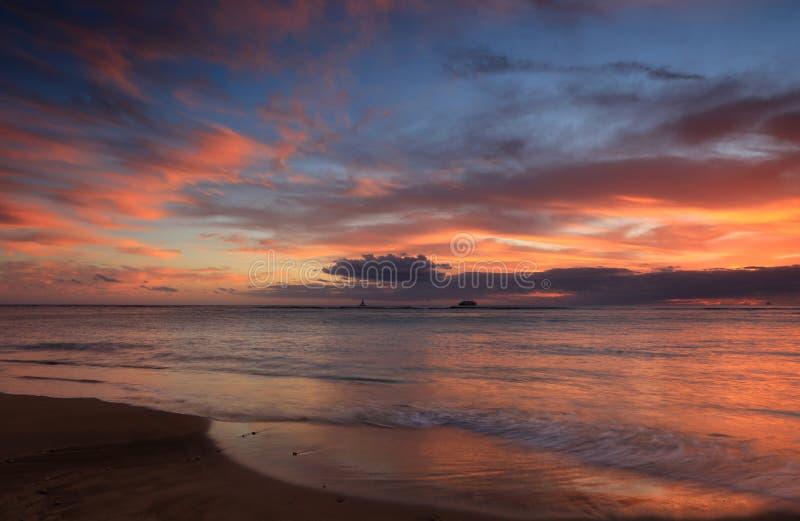 Waikiki beach sunset, Oahu, Hawaii. View of Waikiki beach at sunset, Honolulu, Oahu, Hawaii royalty free stock photos