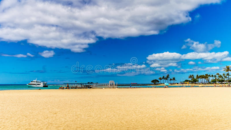 Waikiki beach under blue and partly cloudy sky stock photos