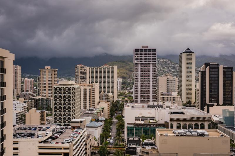 Waikiki Citiscape Post Hurricane Lane. Honolulu, Hawaii / USA - August 26, 2018: Aerial view of clouds over Waikiki tall buildings as aftermath of Hurricane Lane royalty free stock images