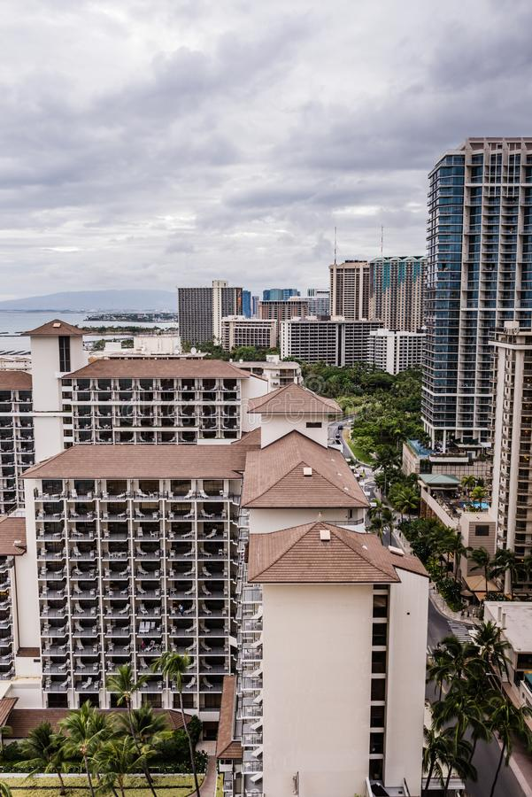 Waikiki Cityscape Post Hurricane Lane. Honolulu, Hawaii / USA - August 26, 2018: Aerial view of clouds over Waikiki tall buildings as aftermath of Hurricane Lane royalty free stock photo
