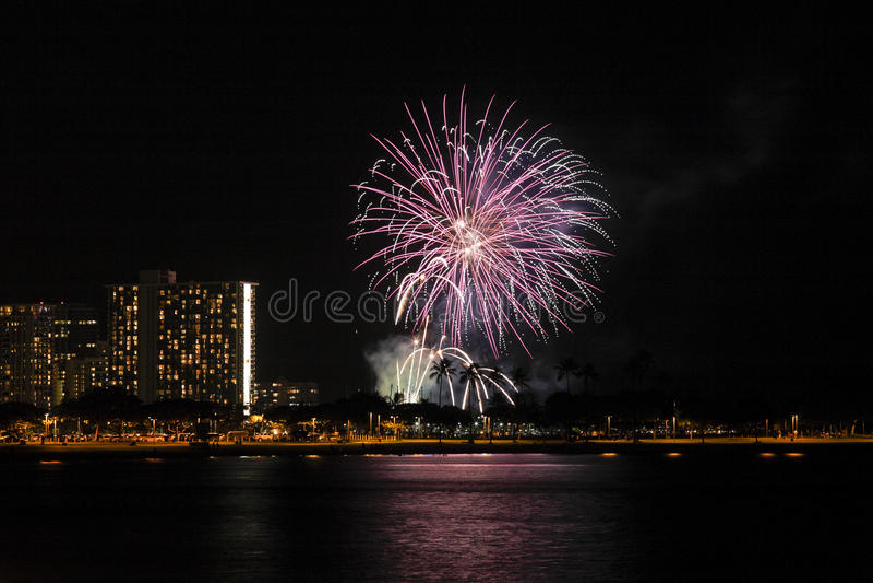 Waikiki Fireworks Display. Honolulu, Hawaii. 18th Sept, 2015. Hilton Hawaiian Village Rainbow Tower fireworks display viewed from Ala Moana Beach Park royalty free stock photo