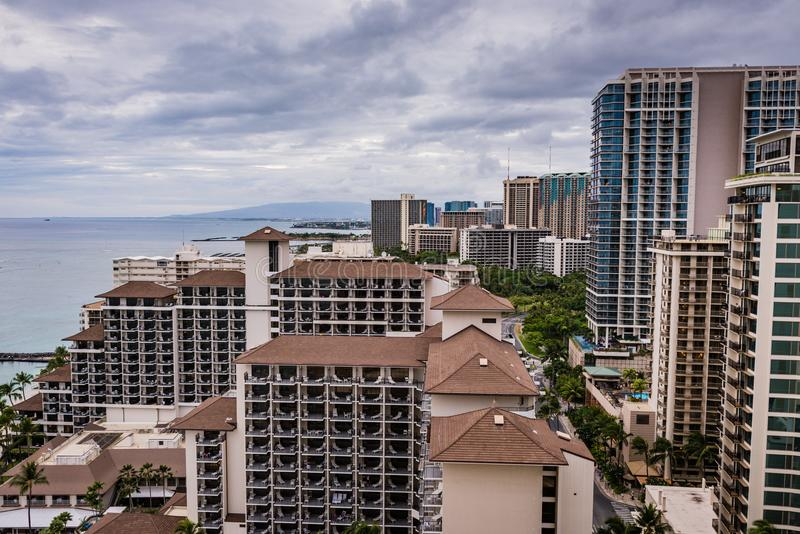 Waikiki Skyscrapers On Coast Post Hurricane Lane. Honolulu, Hawaii / USA - August 26, 2018: Aerial view of clouds over Waikiki shoreline and tall buildings as stock image