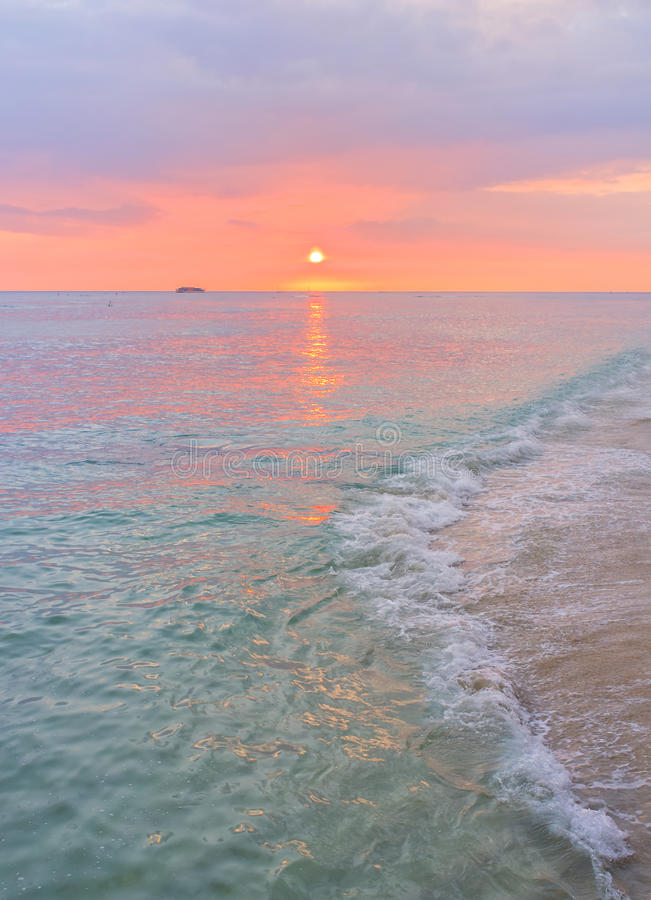 Waikki Beach Sunset, Honolulu, Oahu Hawaii. The pink and blue pastel colors of a sunset on the water and sands of Waikki Beach, on the island of Oahu in Honolulu stock images