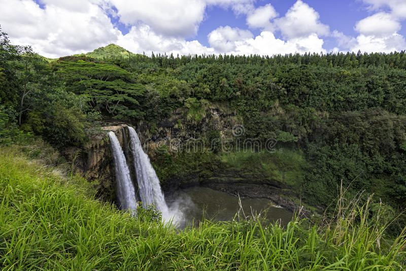 Wailua Falls twin waterfalls, Kauai, Hawaii, United States. Wailua Falls twin waterfalls in a tropical forest, Kauai, Hawaii, United States stock photos