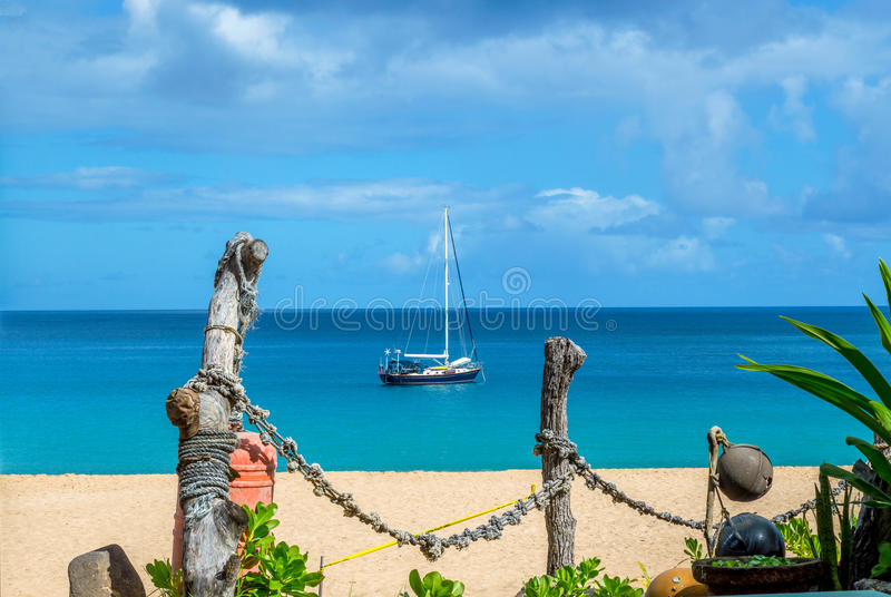 Waimea Bay. Located on the North Shore of Oahu, Hawaii. Waimea Bay famous for its huge winter waves. A beautiful beach with clean white sand and crystal clear stock photography