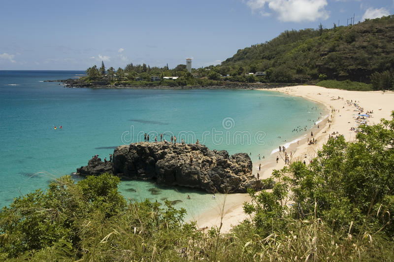 Waimea Beach in Oahu, Hawaii. North Shore. Crystal clear water and big lava rock in a sunny day at the Waimea Bay. North Shore of Oahu. Hawaii stock photo