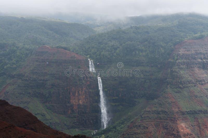 Waimea-Schlucht und Waipoo-Fälle auf Kauai, Hawaii, im Winter nach einem bedeutenden Regensturm stockbilder