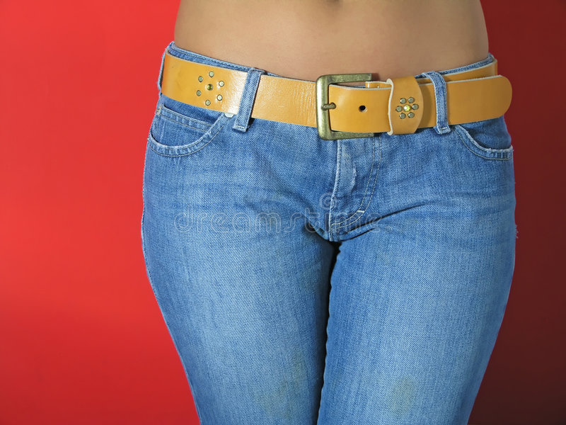 Waist. Girl in Jeans on red background royalty free stock photography