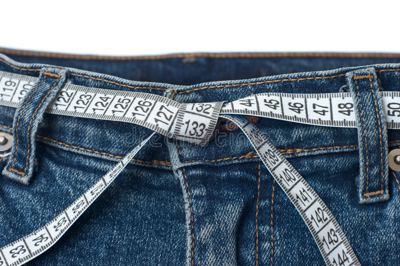 Waist check and excess weight control concept stock photo
