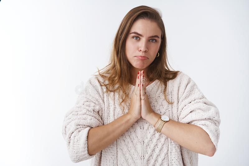 Waist-up attractive silly female friend asking you help pursing lips clingy asking apology, pressing palms together pray. Apologizing, wanna fix relationship stock image