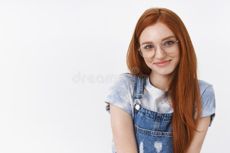 Waist-up cute tender romantic redhead teenage girl blue eyes, modest smile posing flirty and lovely, hold hands together. Grinning look camera sincere joyful royalty free stock images