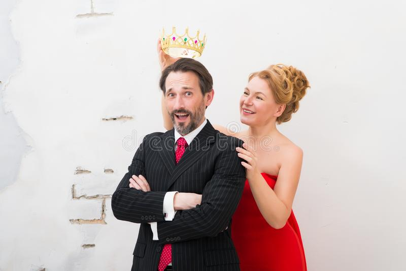 Waist up of delighted businessman with a crown kept above his head royalty free stock images
