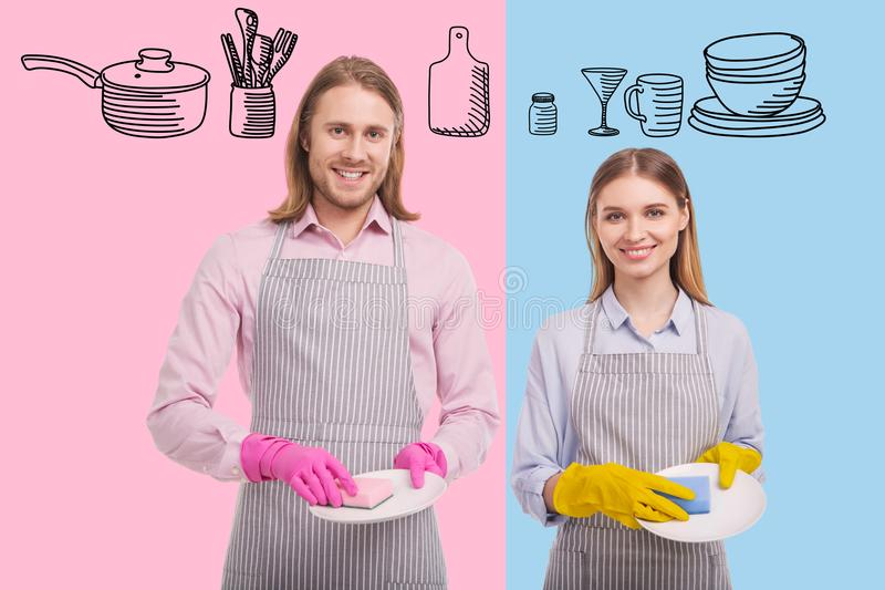 Waist up of delighted family washing dishes together royalty free stock image