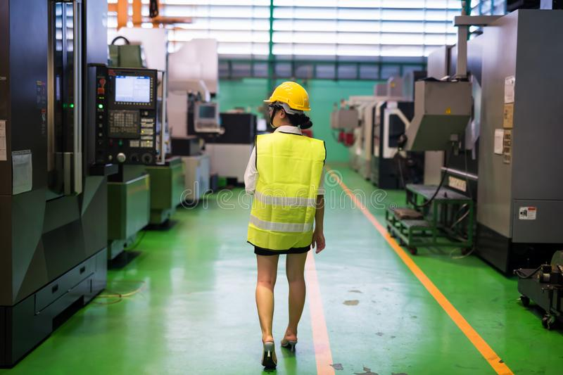 Waist up female engineer check factory machine stock images