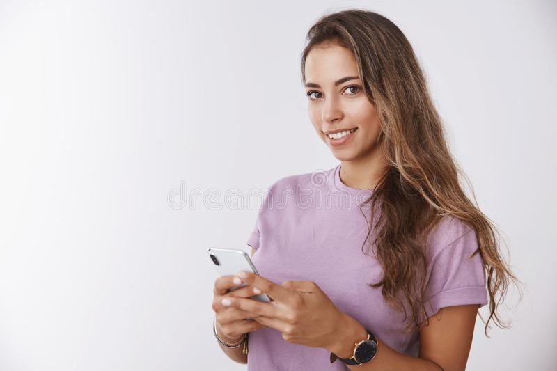 Waist-up gorgeous smiling happy girl holding smartphone looking delighted tender camera, thinking capture under selfie stock photos