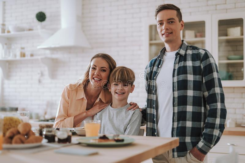 Waist up photo of happy family in the kitchen stock photography