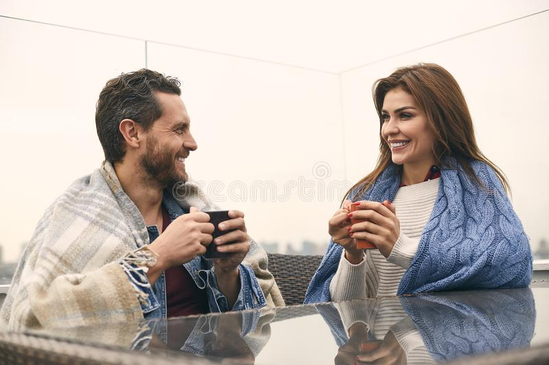 Happy couple is spending time in cafe stock photography