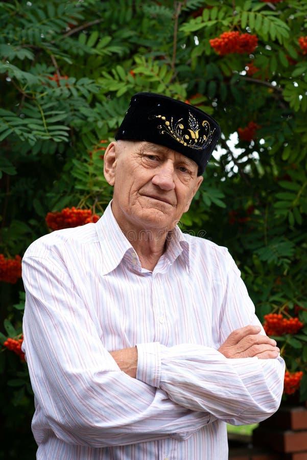 Waist up portrait of an elderly man  Muslim in a skullcap, outdoors royalty free stock photos