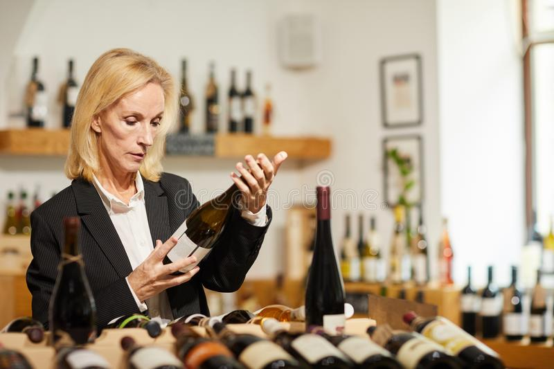 Female Sommelier Choosing Wine royalty free stock images