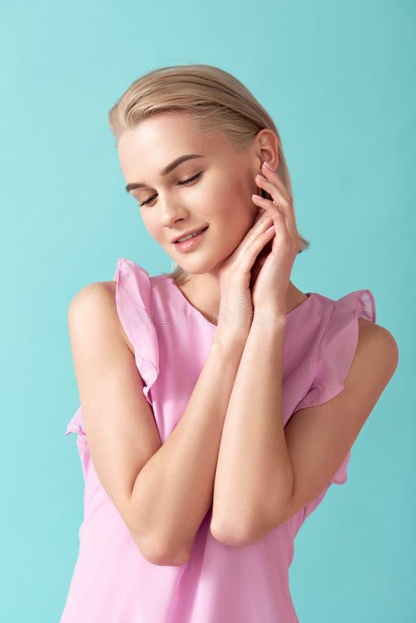 Cute woman in light apparel stock photo