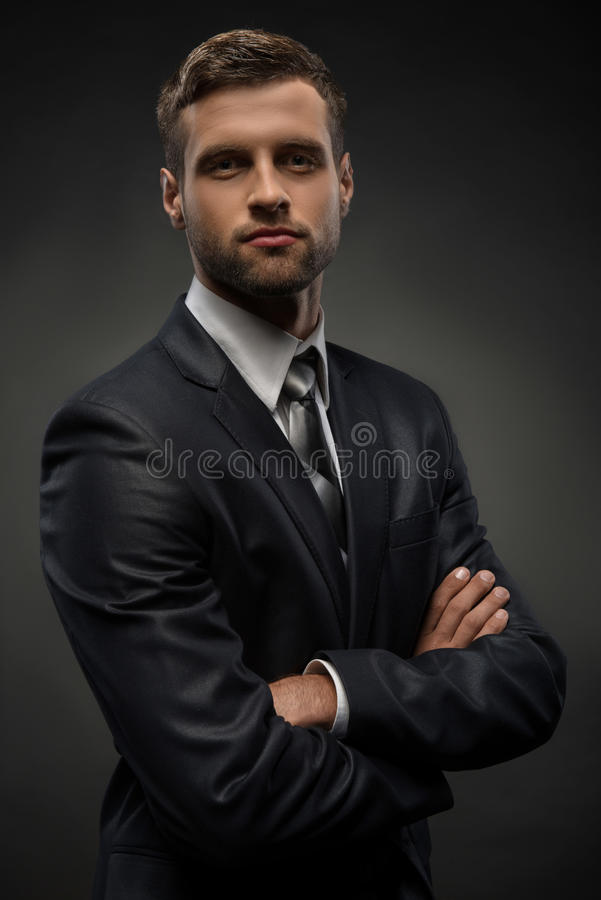 Waist-up portrait of handsome businessman with stock image