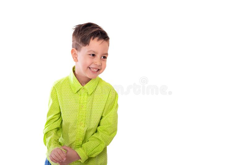 Waist up portrait of a little smiling boy  against a white background with copy space in the studio stock photo