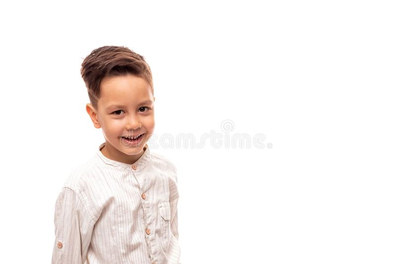 Waist up portrait of a little smiling boy , isolated stock image