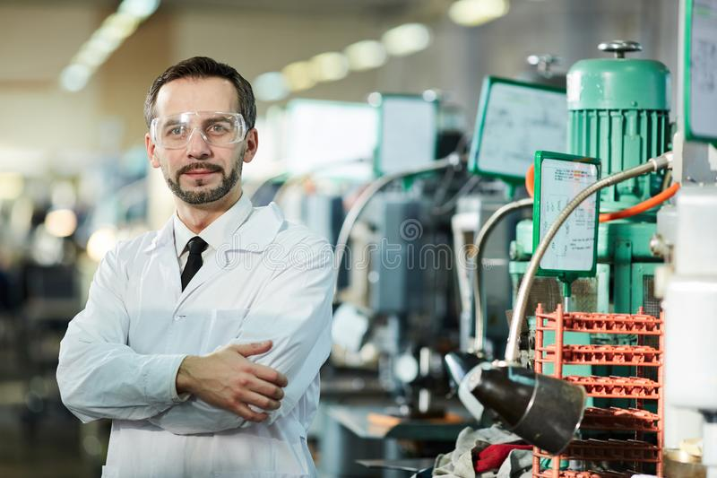 Mature Factory Worker Wearing Lab Coat stock images