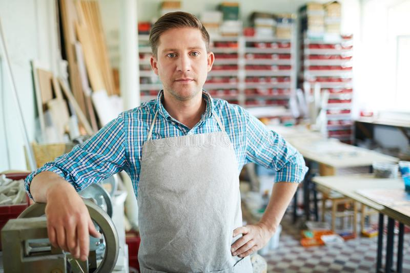 Worker Posing in Crafting Studio royalty free stock photo