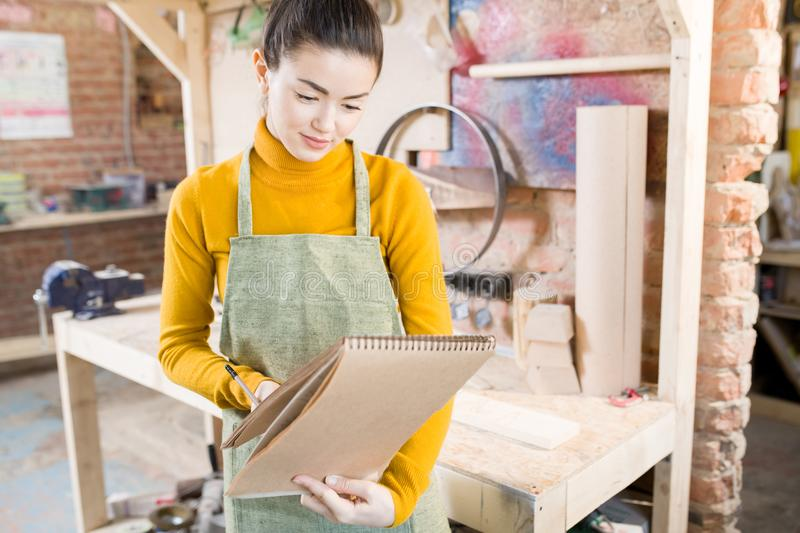 Smiling Female Artisan in Workshop stock photo