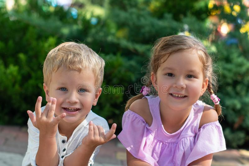 Waist up portrait of two cute little smiling children, boy and g royalty free stock photo