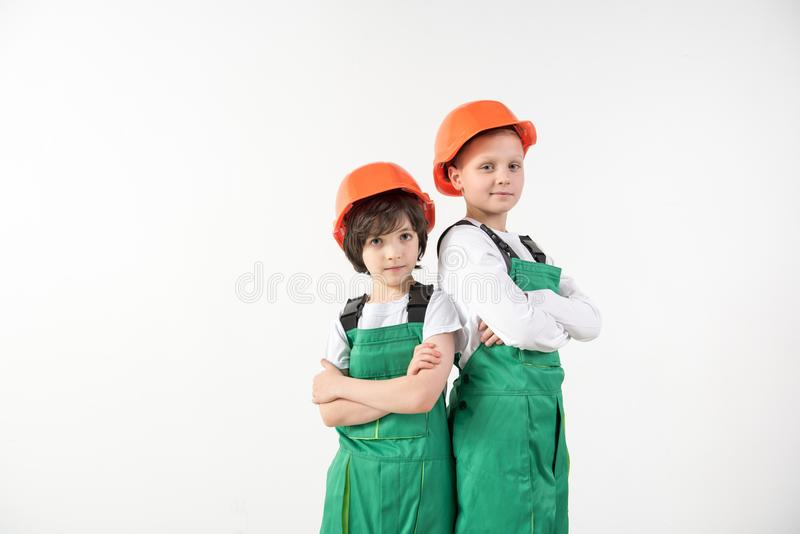 Adherent boys standing in constructor equipment royalty free stock photo