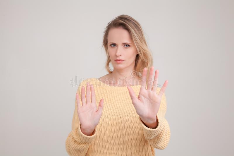 Waist-up portrait of young blonde woman with displeased and sad face expression on face and no gesture, giving refuse. wearing royalty free stock photos