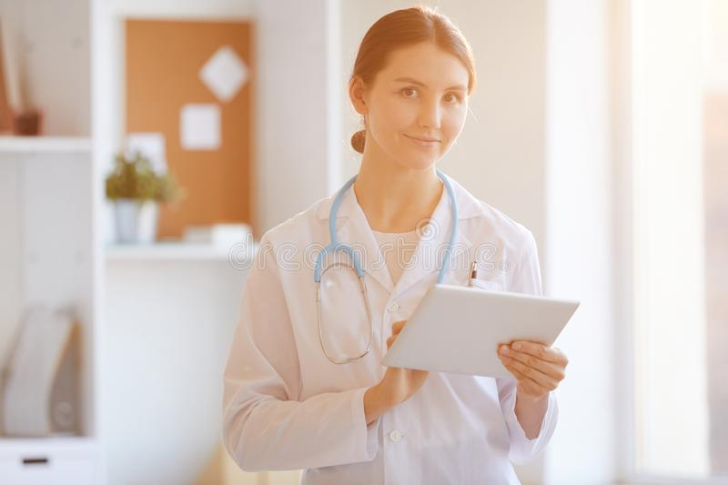 Female Doctor in Sunlight royalty free stock photos