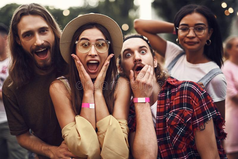 Cheerful hipster friends having fun while spending time outdoors royalty free stock photography