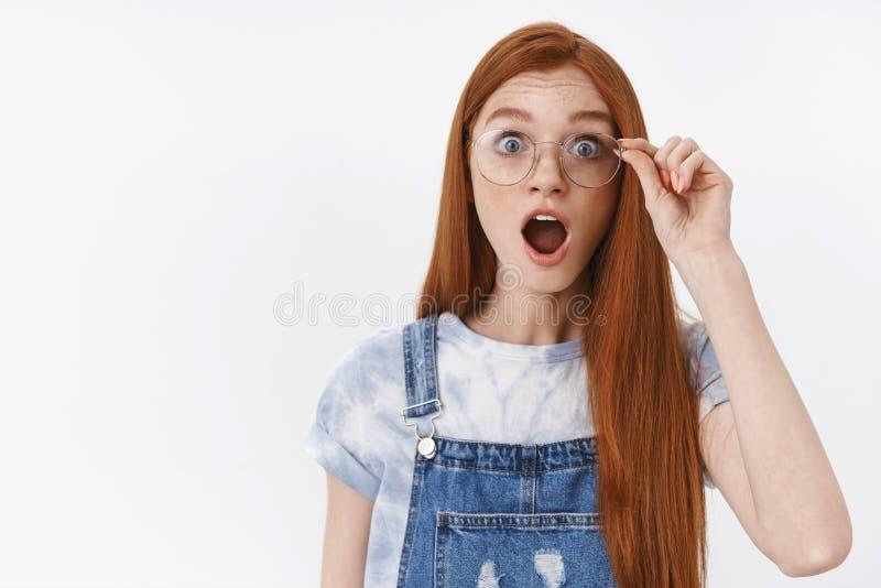 Waist-up shocked impressed cute teenage girl speechless stare camera raise eyebrows popping eyes astonished drop jaw stock photo