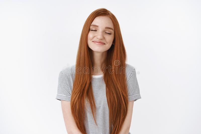 Waist-up shot dreamy romantic charming smiling relaxed redhead girl closed eyes tender delighted smile imagine perfect. Lovely moment daydreaming making wish royalty free stock image