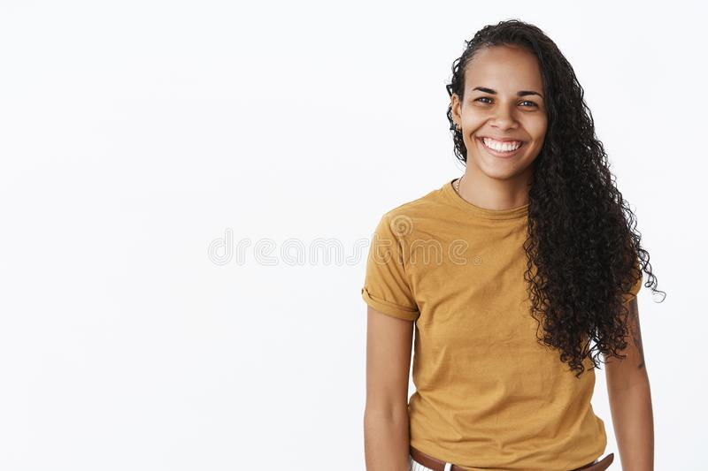 Waist-up shot of friendly-looking satisfied young and creative female entrepreneur starting own business looking. Prominent and optimistic smiling broadly at stock image