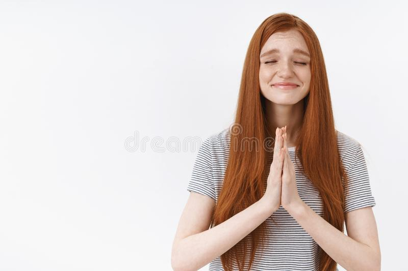 Waist-up shot girl hopefully praying close eyes smiling faithfully wait dream come true have desire cupped hands. Together supplication gesture anticipating stock photography