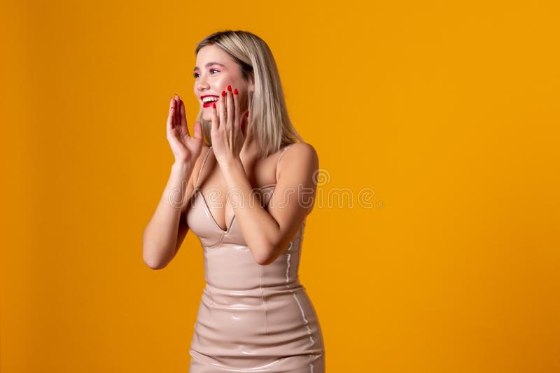 Waist-up shot of positive happy european female with blonde hair stock photos