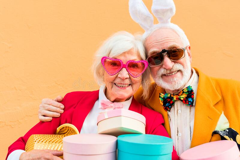 Happy old couple in glasses looking at camera stock photography