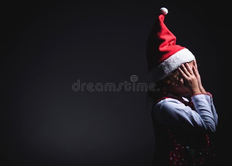 Wait for surprises. Little Santa wait for surprises,blank space and low key technique stock photo