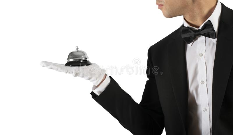 Waiter with bell in hand. Concept of first class service in your business. Waiter holds with bell in hand. Concept of first class service in your business royalty free stock images