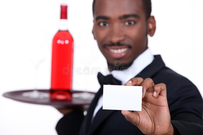 Waiter with a bottle of wine royalty free stock photography