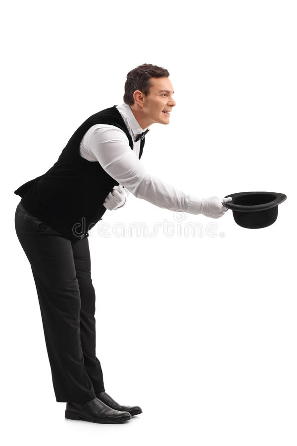 Waiter bow down and taking off his hat royalty free stock images